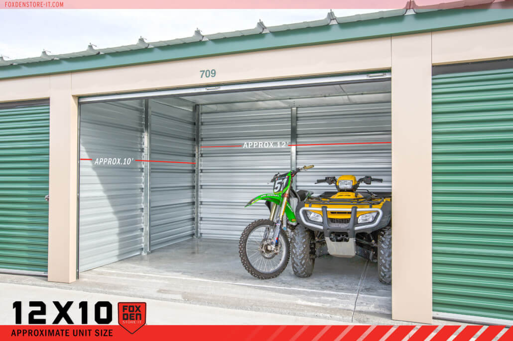View of open storage unit with 2 ATVs inside