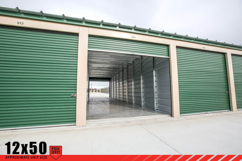 View of open Summerset, SD storage unit with motorcycle inside